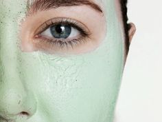 Young woman wearing green facial mask, close-up of eye
